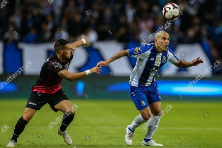 FC Porto's Maxi Pereira (R) in action against Feirense player Luis Machado, during their Portuguese First League soccer match, held at Dragao stadium, Porto, Portugal, 27 October 2018.