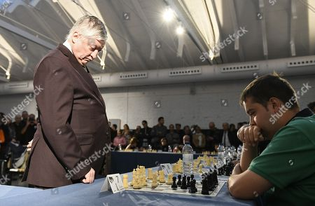 Former Russian chess world champion Anatoly Karpov (L) plays 20 simultaneous chess games at the Chess School of Getafe, Madrid, Spain, 28 October 2018.