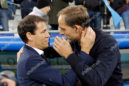 PSG's coach Thomas Tuchel, right, and Marseille's coach Rudi Garcia talk prior to the French League One soccer match between Paris-Saint-Germain and Marseille at the Velodrome Stadium in Marseille, France