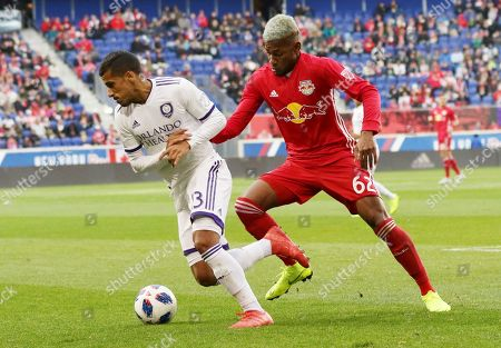 Stock Image of Orlando City defender Amro Tarek, left, moves the ball away from New York Red Bulls defender Michael Amir Murillo during the first half of an MLS soccer match, in Harrison, N.J. The New York Red Bulls won 1-0