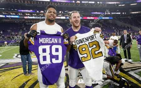 New Orleans Saints defensive end Marcus Davenport, left, swaps jerseys with Minnesota Vikings tight end David Morgan after an NFL football game, in Minneapolis. The Saints won 30-20