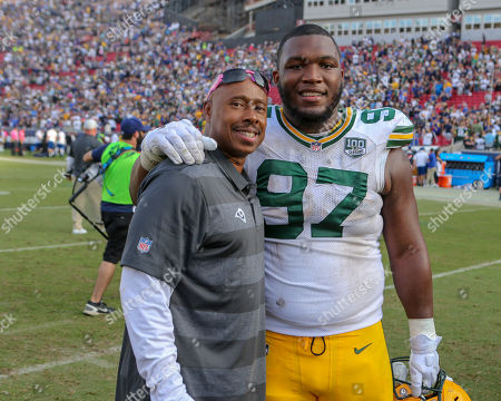 Los Angeles, CA...Green Bay Packers nose tackle Kenny Clark #97 and Rams Assistant coach Yarbers during the NFL Green Bay Packers vs Los Angeles Rams at the Los Angeles Memorial Coliseum in Los Angeles, Ca on , 2018. Jevone Moore