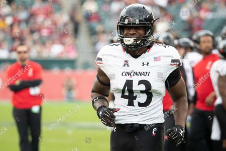 Stock Picture of Cincinnati's defensive end Michael Pitts (43) looks on during the first half of an NCAA college football against Temple, in Philadelphia. Temple won 24-17