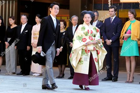 Japanese Princess Ayako, center right, dressed in traditional ceremonial robe, and groom Kei Moriya, center left, arrive at Meiji Shrine for their wedding ceremony in Tokyo, . Japan's Princess Ayako married Moriya, a commoner in a ritual-filled ceremony Monday at Tokyo's Meiji Shrine