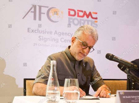 Asia Football Association President Salman Bin Ibrahim Al-Khalifa signs during a press conference in Kuala Lumpur, Malaysia, . The Asian Football Confederation entered an agreement with DDMC for the Commercial Rights for 2021-2028. The new rights agreement will secure AFC Member Associations financial future and help the AFC enhance its competitions and development programs