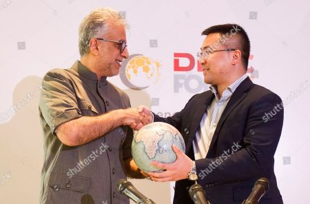 Salman Bin Ibrahim Al-Khalifa, Yi Rentao. Asia Football Association President Salman Bin Ibrahim Al-Khalifa and DDMC Fortis Limited Chairman Yi Rentao shake hands after a signing ceremony in Kuala Lumpur, Malaysia, . The Asian Football Confederation entered an agreement with DDMC for the Commercial Rights for 2021-2028. The new rights agreement will secure AFC Member Associations financial future and help the AFC enhance its competitions and development programs
