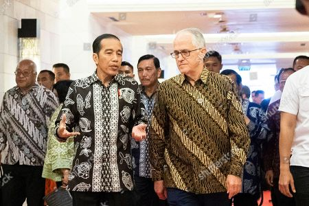 Indonesia President Joko Widodo (L) walks with Former Australian Prime Minister Malcolm Turnbull (R) for a meeting during the fifth Our Ocean Conference in Nusadua, Bali, Indonesia, 29 October 2018. Bali is hosting the fifth Our Ocean Conference on 29 and 30 October 2018. Our Ocean Conference is focused on generating commitments and taking actions to maintain the sustainability of the oceans.