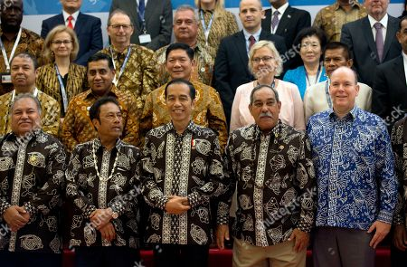 """From left in front, Nauru President Baron Waqa, Palau's President Tommy Remengesau Jr., Indonesian President Joko """"Jokowi"""" Widodo, Micronesia President Peter Christian and Prince Albert II of Monaco pose for a photograph during Our Ocean Conference in Bali, Indonesia . The two-day meeting focuses on generating commitments and taking actions to maintain the sustainability of our oceans"""