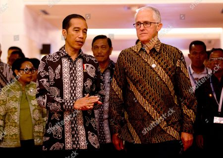 """Joko """"Jokowi"""" Widodo, Malcolm Turnbull. Indonesia President Joko """"Jokowi"""" Widodo, front left, walks with Australia former Prime Minister Malcolm Turnbull, front right, during their bilateral meeting at Our Ocean Conference in Bali, Indonesia . The two-day meeting focuses on generating commitments and taking actions to maintain the sustainability of our oceans"""
