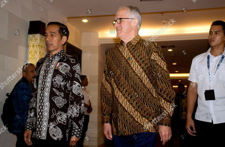 """Joko """"Jokowi"""" Widodo, Malcolm Turnbull. Indonesia President Joko ''Jokowi"""" Widodo, left, walks with Australia former Prime Minister Malcolm Turnbull, center, during their bilateral meeting at Our Ocean Conference in Bali, Indonesia . The two-day meeting focuses on generating commitments and taking actions to maintain the sustainability of our oceans"""