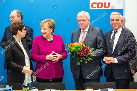 (L-R) CDU Secretary General Annegret Kramp-Karrenbauer, German Chancellor Angela Merkel, Deputy Leader of the Christian Democratic Union (CDU) Volker Bouffier, and vice-chairman of the CDU Thomas Strobl, pose for the cameras prior to a Federal Board Meeting of the Christian Democratic Union (CDU) at the CDU's headquarters in Berlin, Germany, 29 October 2018. The federal board meets the day after federal state Hesse's regional elections that saw an upset for the parties ruling in the federal government. Local media reported that Merkel will not run for another term of leadership for the CDU.