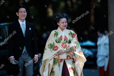Japan Princess Ayako, the third daughter of the late Prince Takamado, and Kei Moriya walk down the aisle at the Meiji-Jingu shrine following their wedding