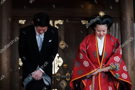 Japan Princess Ayako, the third daughter of the late Prince Takamado, and Kei Moriya bow to journalist during a press conference at the Meiji-Jingu shrine after their wedding