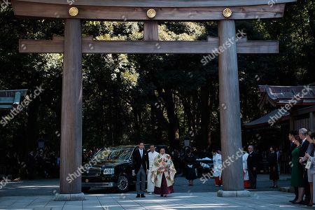 Japan Princess Ayako, the third daughter of the late Prince Takamado, and Kei Moriya walk down the aisle at the Meiji-Jingu shrine following their wedding