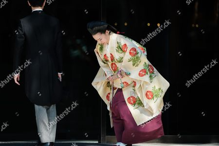 Japan Princess Ayako, the third daughter of the late Prince Takamado, and Kei Moriya bow to audience at the Meiji-Jingu shrine following their wedding
