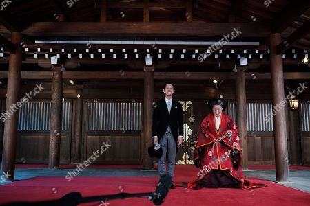 Japan Princess Ayako, the third daughter of the late Prince Takamado, and Kei Moriya attend a press conference at the Meiji-Jingu shrine after their wedding
