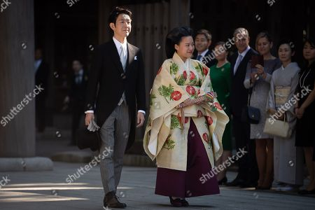 Japanese Princess Ayako, the third daughter of the late Prince Takamado, and Kei Moriya walk down the aisleat the Meiji-Jingu shrine following their wedding