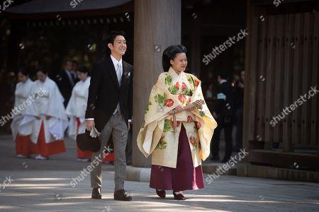 Stock Image of Japanese Princess Ayako and Kei Moriya walk down the aisle at the Meiji-Jingu shrine following their wedding