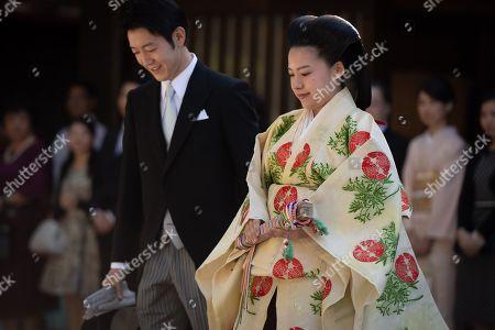 Stock Picture of Japanese Princess Ayako, the third daughter of the late Prince Takamado, and Kei Moriya walk down the aisle at the Meiji-Jingu shrine following their wedding, Tokyo