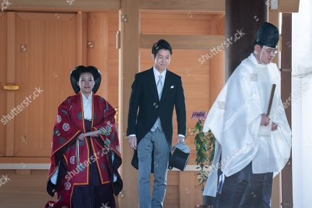 Japanese Princess Ayako, the third daughter of the late Prince Takamado, and Kei Moriyado the shinto ritual during their wedding ceremony at the Meiji-Jingu shrine in Tokyo