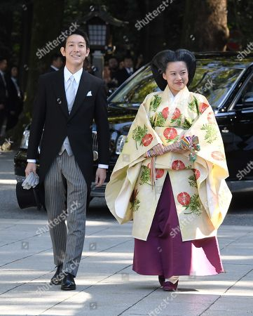 Stock Image of Japanese Princess Ayako (R), 28-year-old daughter of late Prince Takamado, and Kei Moriya, 32, an employee of Japanese shipping firm, arrive.at Meiji Shrine in Tokyo, Japan, 29 October 2018 for their wedding ceremony.