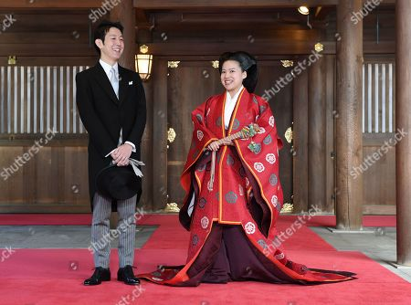 Japanese Princess Ayako (R), 28-year-old daughter of late Prince Takamado, and Kei Moriya, 32, an employee of Japanese shipping firm, talks to journalist after their wedding ceremony.at Meiji Shrine in Tokyo, Japan, 29 October 2018.