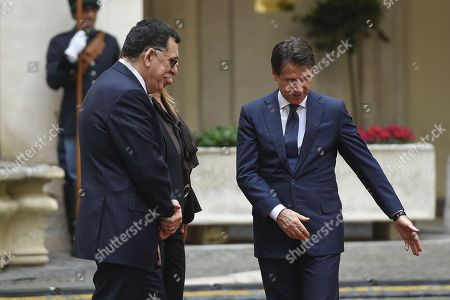 Italy's Prime Minister Giuseppe Conte (R) welcomes the Chairman of the Presidential Council of Libya, Fayez al-Sarraj (L) at the Chigi palace in Rome