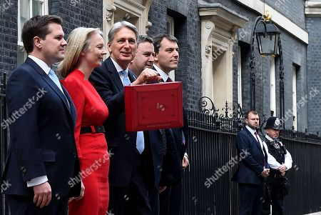 British Chancellor of the Exchequer Philip Hammond (C) and members of the treasury team depart No11 Downing Street on his way to parliament in London, Britain, 29 October 2018. Hammond is set to deliver his Budget statement to MP's (Members of Parliament) at the House of Commons. L-R, Exchequer Secretary to the Treasury, Robert Jenrick, Chief Secretary to the Treasury, Elizabeth Truss, Financial Secretary to the Treasury, Mel Stride and Economic Secretary to the Treasury, John Glen.