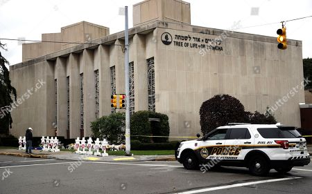 A police vehicle is posted near the Tree of Life/Or L'Simcha Synagogue in Pittsburgh, . Tree of Life shooting suspect Robert Gregory Bowers is expected to appear in federal court Monday. Authorities say he expressed hatred toward Jews during the rampage Saturday morning and in later comments to police