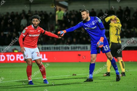 Liam Bridcutt (26) of Nottingham Forest fist bumps Luke Steele (15) of Nottingham Forest after he makes a full stretch save