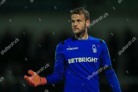 Luke Steele (15) of Nottingham Forest looks for a corner