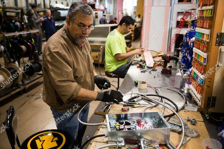 Sarmad Eskandar, left, and Mustpha Damen work on electrical components at the Howard McCray's commercial refrigeration manufacturing facility in Philadelphia. The tax cuts that President Donald Trump pushed through Congress last year sharply reduced the tax burden on businesses. Yet Christopher Scott, president of Howard McCray, says that for his company, the higher tariffs, which are taxes on imports, have largely nullified any benefit he expected from the tax cuts