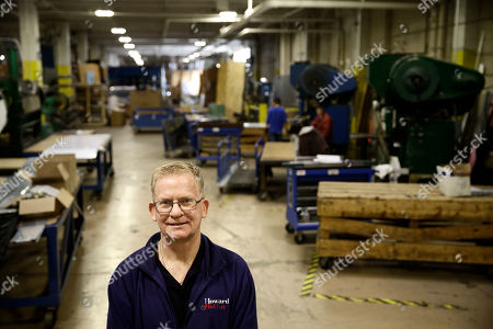 Christopher Scott, president of Howard McCray poses for a photograph at the company's commercial refrigeration manufacturing facility in Philadelphia. The tax cuts that President Donald Trump pushed through Congress last year sharply reduced the tax burden on businesses. Yet Scott says that for his company, the higher tariffs, which are taxes on imports, have largely nullified any benefit he expected from the tax cuts