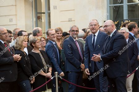 New Agriculture Minister Didier Guillaume (L) walks next to former Agriculture Minister Stephane Travert.
