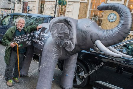 Bill Oddie and a life-size inflatable elephant with the slogan 'Ban Trophy Hunting' protest outside Botswana High Commission, deliver a letter addressed to the President and hand in a 250,000-strong petition. They are condemning plans to allow trophy hunters to kill elephants in the world's most important population as 'potentially disastrous'.