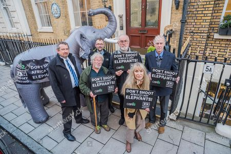 Eduardo Goncales, Bill Oddie, Mark Jones, Peter Egan, Carol Royle, Sir Ranulph Fiennes and a life-size inflatable elephant with the slogan 'Ban Trophy Hunting' protest outside Botswana High Commission, deliver a letter addressed to the President and hand in a 250,000-strong petition. They are condemning plans to allow trophy hunters to kill elephants in the world's most important population as 'potentially disastrous'.