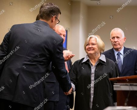 Judy (C) and Dennis (R) Shepard, the parents of Matthew Shepard, greet participants before speaking at a law enforcement roundtable on improving the identification and reporting of hate crimes in Washington, DC, USA, 29 October 2018. Deputy US Attorney General Rod Rosenstein announced the creation of a new hate crimes website at the Department of Justice. Matthew Shepard, a gay man, was killed in 1998.