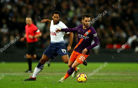Mousa Dembele of Tottenham Hotspur and Bernardo Silva of Manchester City in action