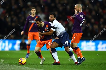 Mousa Dembele of Tottenham Hotspur tries to stop Bernardo Silva of Manchester City