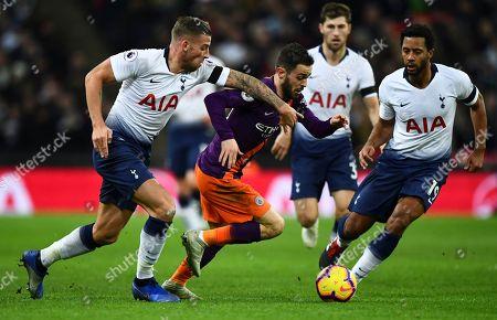 Bernardo Silva of Manchester City in between Toby Alderweireld and Mousa Dembele of Tottenham Hotspur
