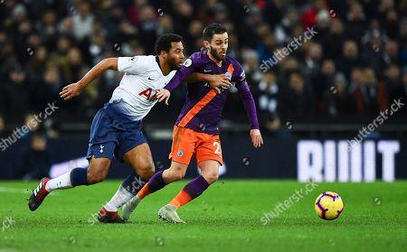 Mousa Dembele of Tottenham Hotspur and Bernardo Silva of Manchester City