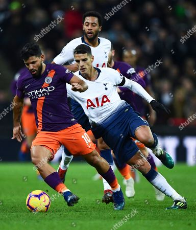 Bernardo Silva of Manchester City gets away from Erik Lamela and Mousa Dembele of Tottenham Hotspur