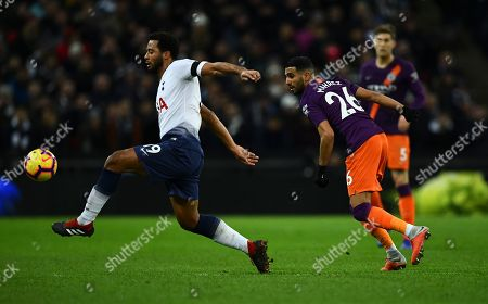 Mousa Dembele of Tottenham Hotspur watched by Riyad Mahrez of Manchester City