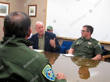 In this Rep. Greg Gianforte speaks during a meeting with leaders from the Montana Department of Justice and Montana Highway Patrol in Helena, Mont.. Gianforte is running against Democratic challenger Kathleen Williams to keep the congressional seat he won last year in a special election