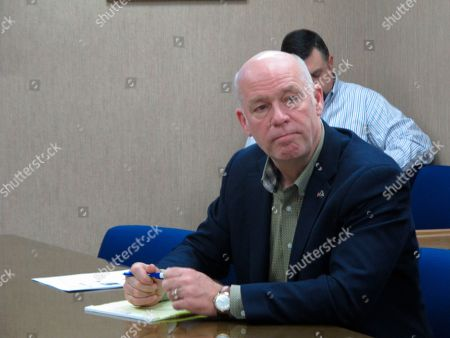 Rep. Greg Gianforte listens during a meeting with leaders from the Montana Department of Justice and Montana Highway Patrol in Helena, Mont.. Gianforte is running against Democratic challenger Kathleen Williams to keep the congressional seat he won last year in a special election