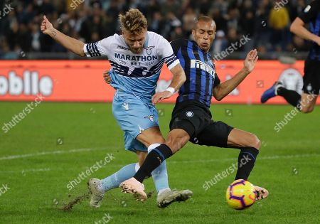 Lazio's Ciro Immobile, left, and Inter Milan's Joao Miranda fight for the ball during a Serie A soccer match between Lazio and Inter Milan, at Rome's Olympic stadium