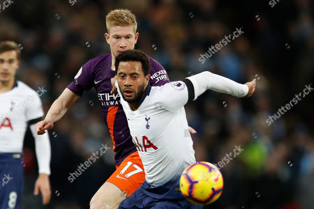 French President Emmanuel Macron and South Korean President Moon Jae-in attend a meeting at the Elysee Palace in Paris. Tottenham's Mousa Dembele, foreground, watches the ball as he challenges with Manchester City's Kevin De Bruyne during the English Premier League soccer match between Tottenham Hotspur and Manchester City at Wembley stadium in London, England