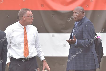 Stock Photo of Cleveland Browns general manager John Dorsey, left, talks with Baltimore Ravens general manager Ozzie Newsome before an NFL football game, in Cleveland. The Browns won 12-9