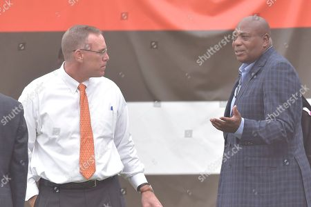 Stock Picture of Cleveland Browns general manager John Dorsey, left, talks with Baltimore Ravens general manager Ozzie Newsome before an NFL football game, in Cleveland. The Browns won 12-9