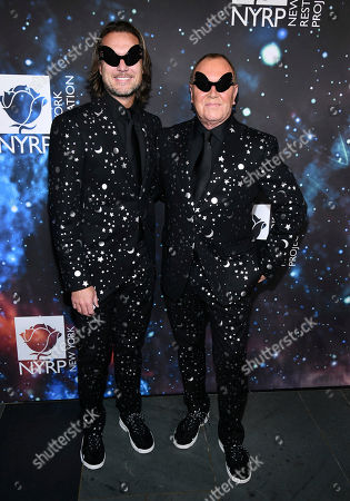 Lance LePere, Michael Kors. Lance LePere, left, and Michael Kors attend Bette Midler's New York Restoration Project's 22nd annual Hulaween party at the Cathedral of St. John the Divine, in New York